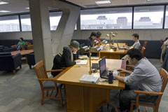 photo of students working in the graduate reading room in Scott Library