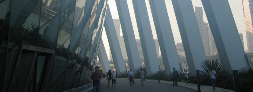 photo of a large building with small people walking around the base to illustrate knowledge systems